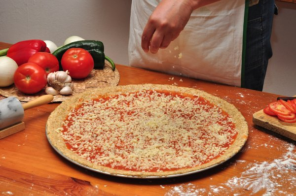 Pizza Making 5: Shots of the pizza making process, step by step - Adding the cheese