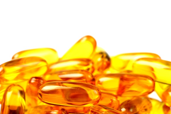 Fish oil: Fish oil pills with white background