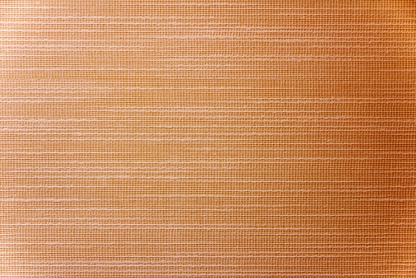 Textured Wallpaper: Lacy wallpaper freshly applied to a yellow wall to give the wall some texture.