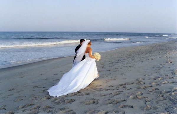 Beach Wedding: A couple on Tybee Beach, Georgia, right after they had exchanged vows