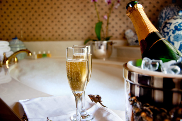 Bubbly and Bubbly: Champagne and a bubbly bath.