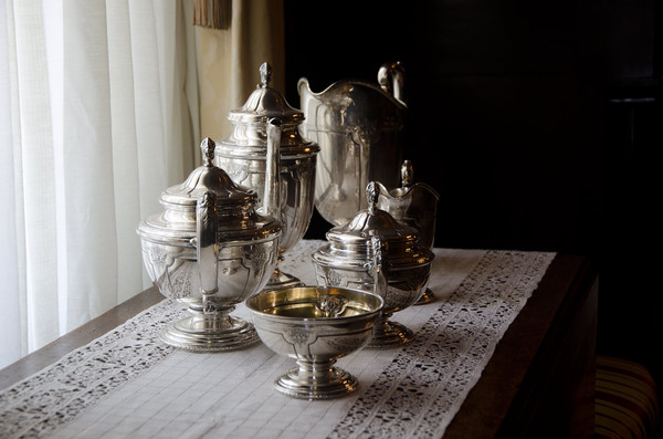 Silver service: 19th century silver tea service on a 19th century lace cloth