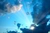 Sunburst in cloudy Sky
