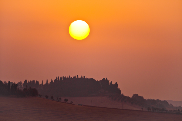 Tuscany Sunrise: Rising Sun above the Hills aroud Siena