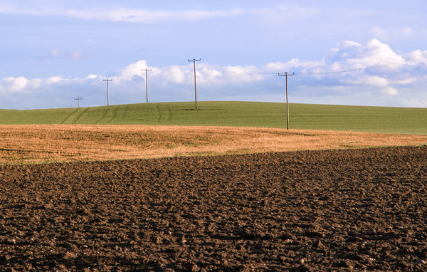 Rolling Hills with Electricity: Rolling Hills with Electricity Poles and Power Lines