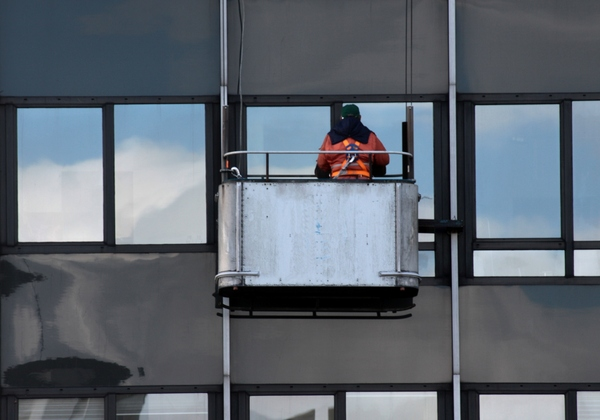 Window cleaning: Industrial window cleaner at work