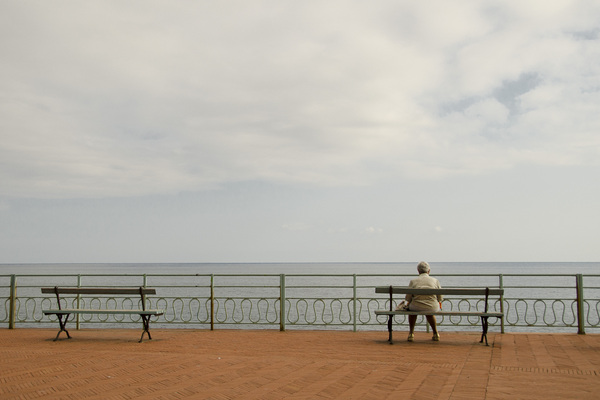 Solitude at sea: Woman, sittin' on her own, at the passeggiata form Quinto al Mare, Genova