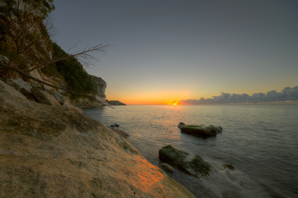 Sunrise at Stevns - HDR: Sunrise at the famours chalkcliff Stevns Klint in Denmark. The image is HDR.