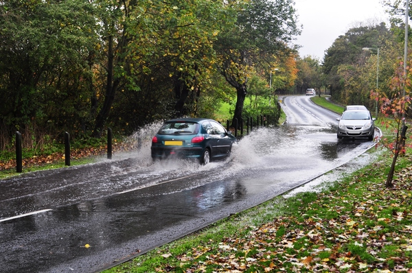 Floods: Flooded road, in Autumn, still raining.