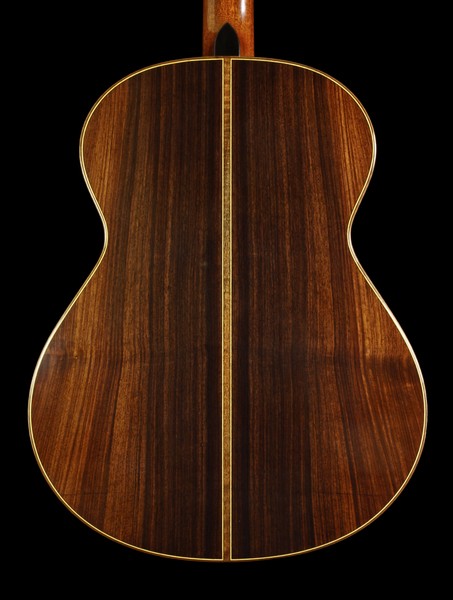 Custom Made Guitar Back: The beautiful wood grain and hand inlay of a guitar.