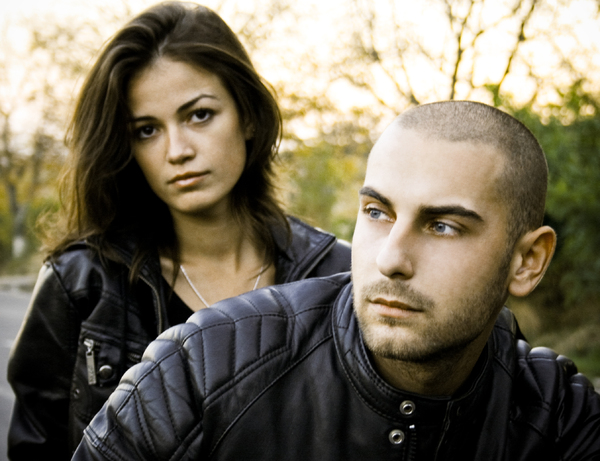 couple portrait: young couple portrait in black leather jacket's