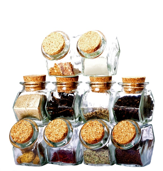 Pyramid of spices: glasses with spices and herbs forming a pyramid