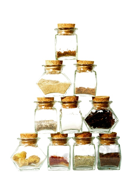 Spicy pyramid: Glasses with spices and herbs forming a pyramid
