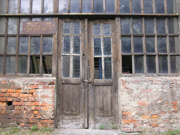 Old door: Wooden door. Sucha Beskidzka's castle area. Workshops building.