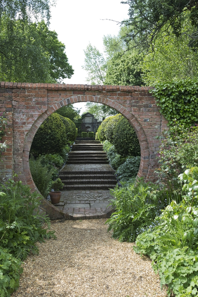 Garden circle: An ocular brick wall feature in a garden in Hampshire, England.