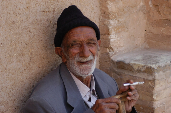 Old Man: Old man smoking cigarette.