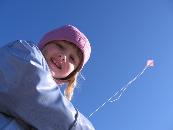 Flying a kite: A young girl flying a kite on a spring day