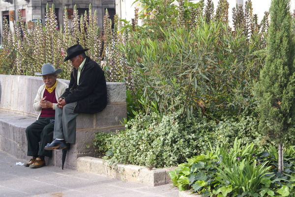 A placid old age: Two elderly men spend their time in a placid chat in the park of Quetzaltenango Guatemala