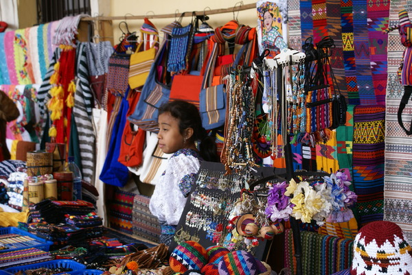 indian market: Young Indian girl selling handmade souvenirs