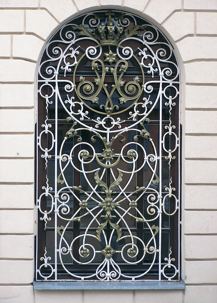 Decorative barred window: A window with decorative bars.