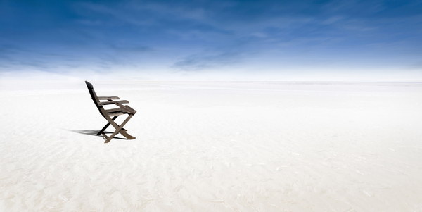 Chair on empty beach: Picture of the beach was taken in Zeeland, the Netherlands and photoshopped