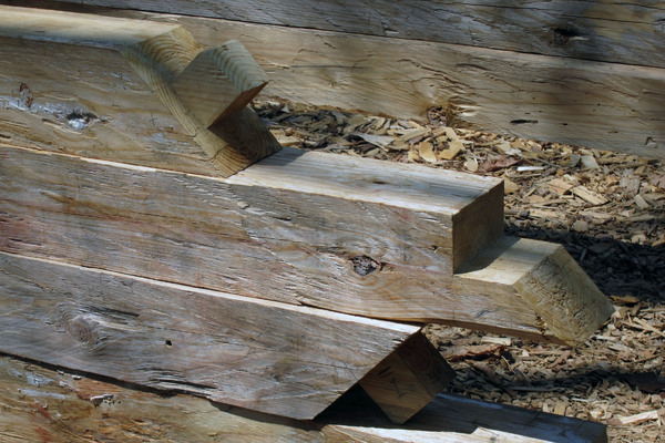 Timber Construction: Timber used in log cabin construction.