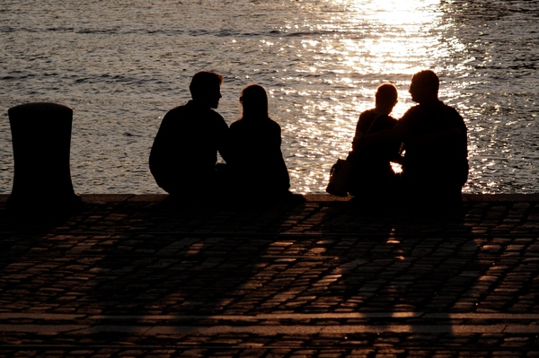 Love on the quay: Two couples enjoying the sunset from the quay.