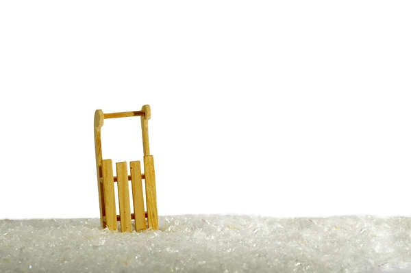 Toboggan in snow: Decoration toboggan in snow. Isolated with white background.