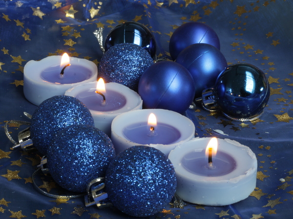 Blue Christmas Decoration: Baubles and candles on a sparkling blue background