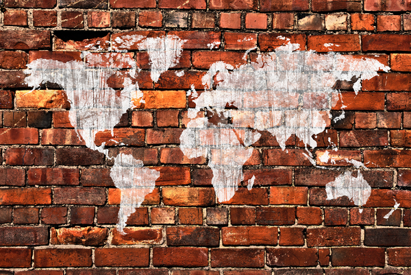Grafitti Map: A weathered painted map on a grungy brick wall.