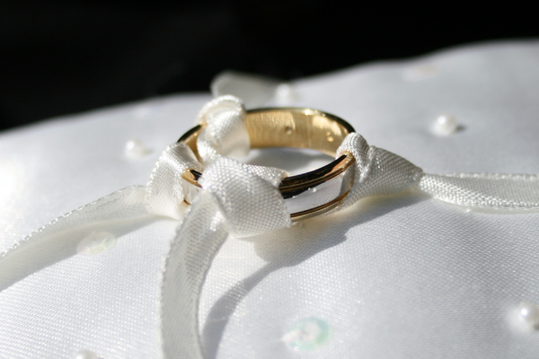 Wedding Ring: Wedding ring on cushion