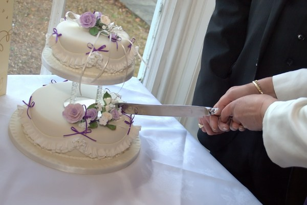 Wedding Cake: Cutting wedding cake at reception