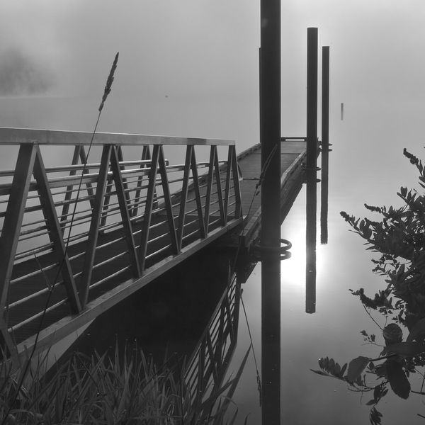 boat dock in fog: no description