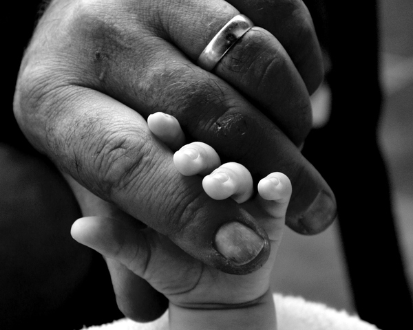 Two Hands 2: Father and new-born son's hands