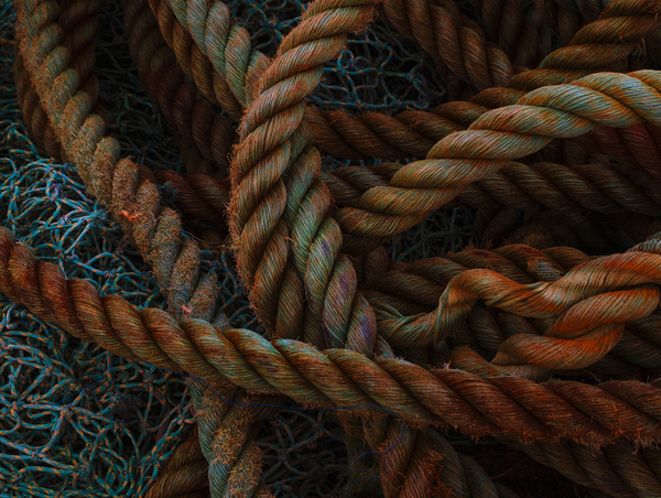 Nets: A fisherman's ropes and nets, piled on a wharf