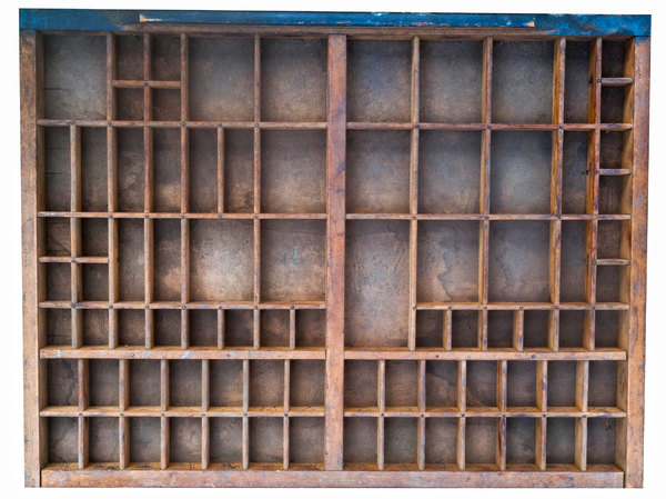 Wooden compartments: An old printers sorting box for letters