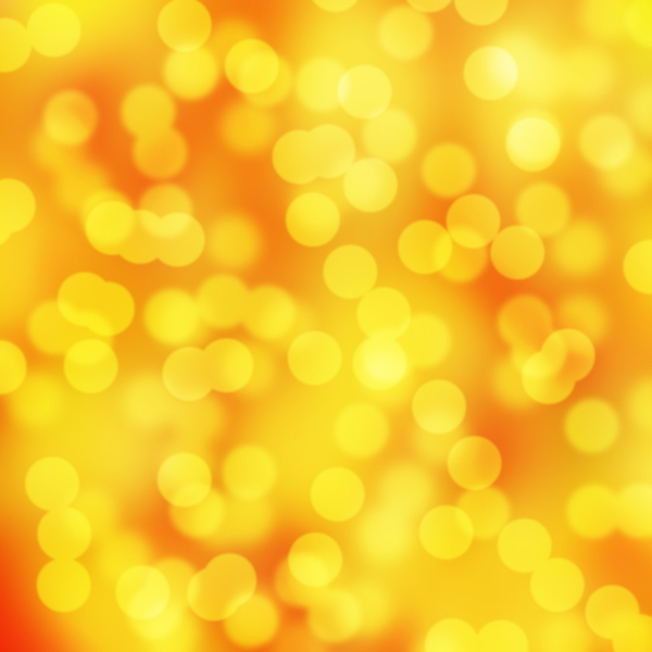Gold Bokeh: Gold background bokeh effect.