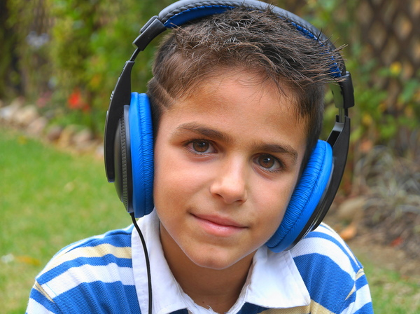 Boy listening to music: no description