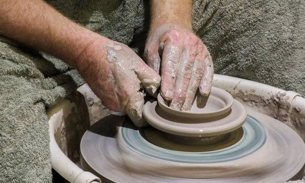 Potter: A potter at a pottery wheel.