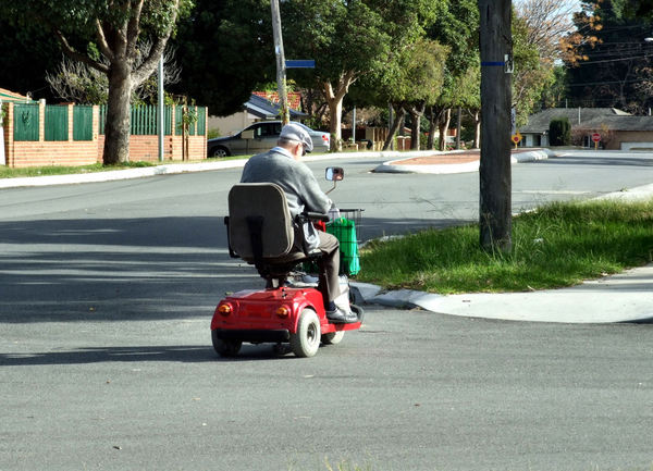 senior's transport: senior citizen on electric gopher