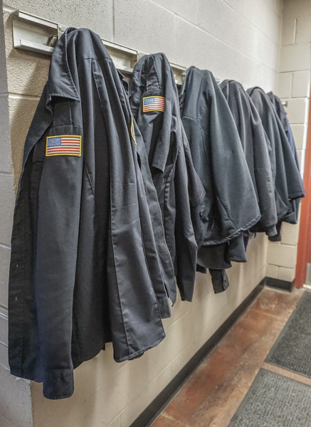 Firefighter Jackets: Firefighter jackets hung in a fire station