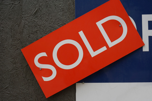 Sign: A sold sign.