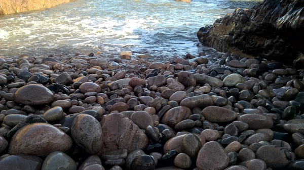 Water touching stones: Taken on a beach in Portknockie